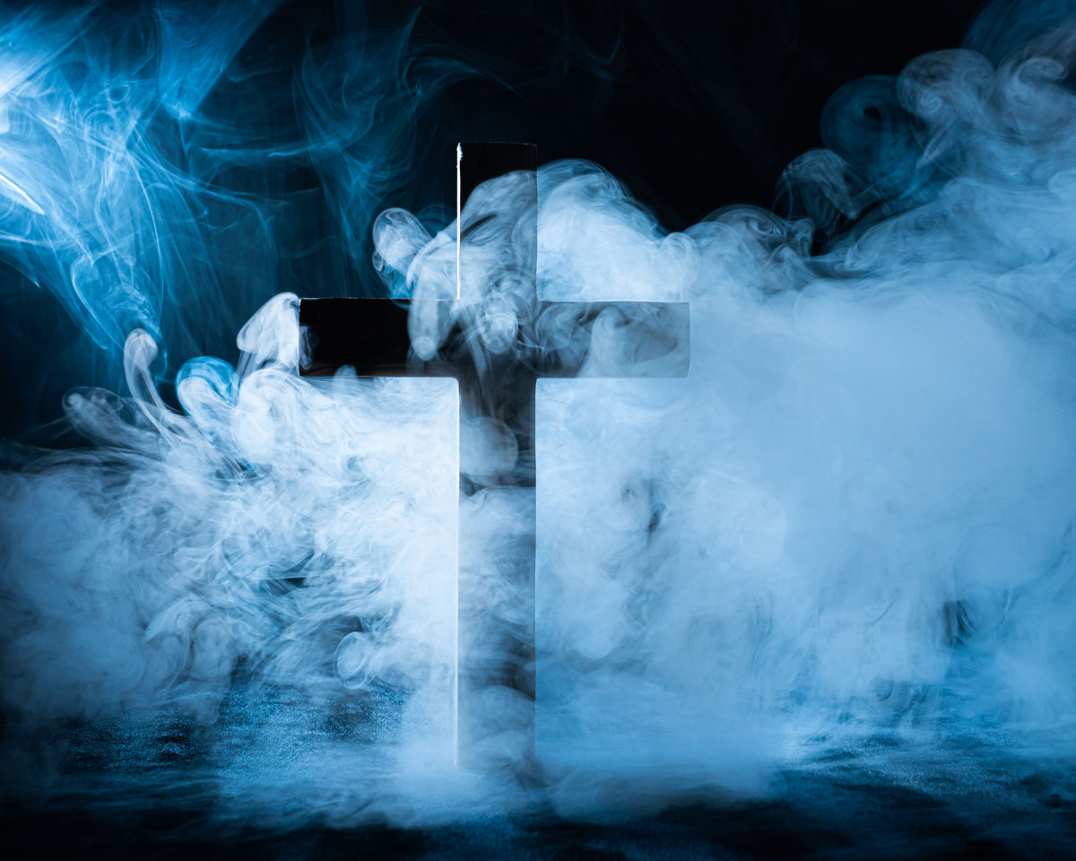 Christian Cross with Smoke And Back Lights